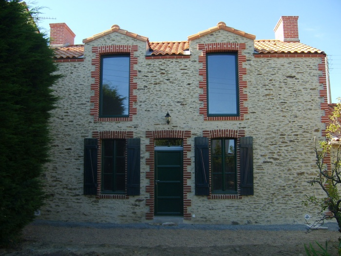 Surélévation d'une maison et construction d'un garage